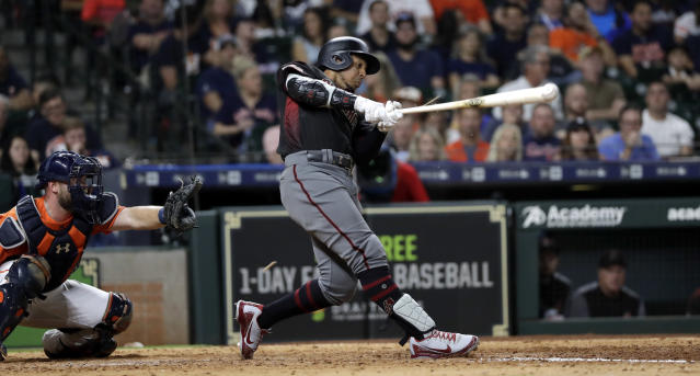 FILE - In this Sept. 14, 2018, file photo, Arizona Diamondbacks' Jon Jay, right, hits a triple to score Nick Ahmed as Houston Astros catcher Brian McCann looks on at left, during the eighth inning of a baseball game, in Houston. The Chicago White Sox and free-agent outfielder Jon Jay have finalized a $4 million, one-year contract. The 33-year-old Jay played for Kansas City and Arizona last season, batting .268 with three homers and 40 RBIs in 143 games. (AP Photo/David J. Phillip, File)