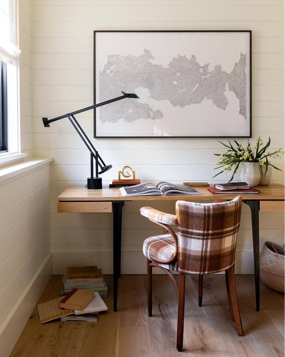 """<p>Though this is a second home, Beers and his team <a href=""""https://www.marthastewart.com/1505155/easy-tips-ultimate-home-office"""" rel=""""nofollow noopener"""" target=""""_blank"""" data-ylk=""""slk:crafted an office"""" class=""""link rapid-noclick-resp"""">crafted an office</a> big enough to get things done—but small enough to not get stuck in. """"We wanted to provide a quiet nook to leave a laptop and some light paperwork that wouldn't be in the way of the public spaces,"""" says Beers, noting that the client preferred to keep these essentials off of the kitchen island. """"We designated the area at the top of the stairs as a small study, with just enough space to pound out a few emails or catch up on bills or news.""""</p>"""