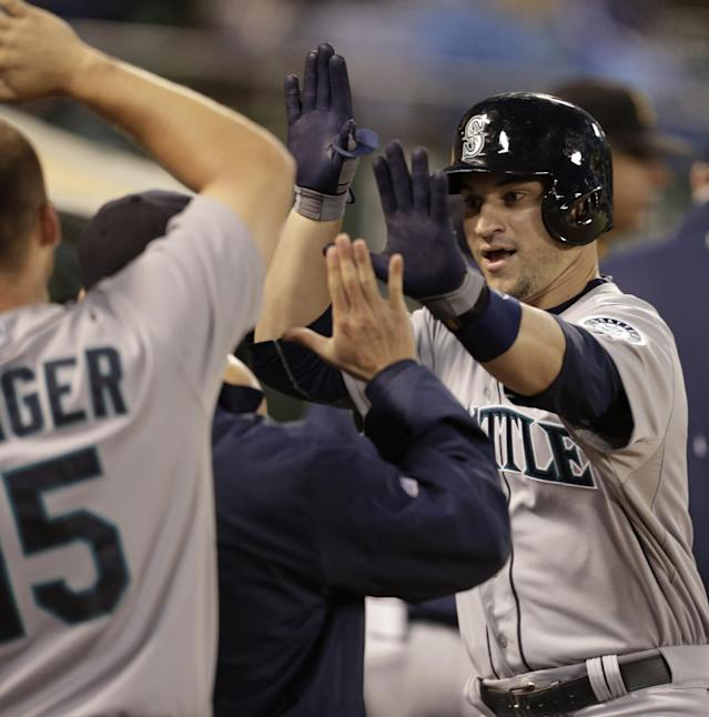 Seattle Mariners' Mike Zunino, right, is congratulated after hitting a home run against the Oakland Athletics in the seventh inning of a baseball game Friday, June 14, 2013, in Oakland, Calif. (AP Photo/Ben Margot)