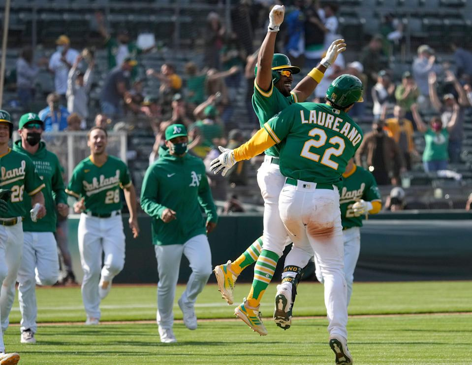Oakland players celebrate their walk-off win against Minnesota on Wednesday.