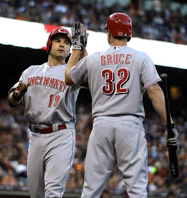 Cincinnati Reds' Joey Votto, left, is congratulated by Jay Bruce (32) after Votto scored against the San Francisco Giants in the third inning of a baseball game Wednesday, July 24, 2013, in San Francisco. Votto scored on a single by Reds' Brandon Phillips. (AP Photo/Ben Margot)