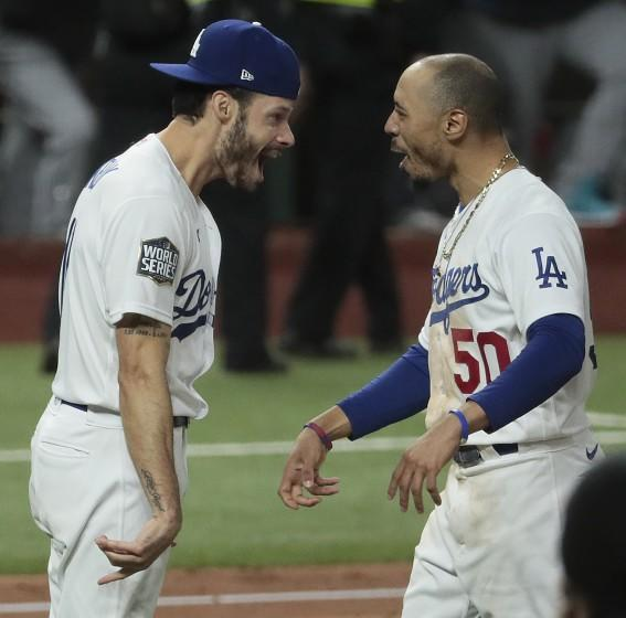 Mookie Betts and Joe Kelly share a moment as the Dodgers celebrate winning the World Series at Globe Life Field.