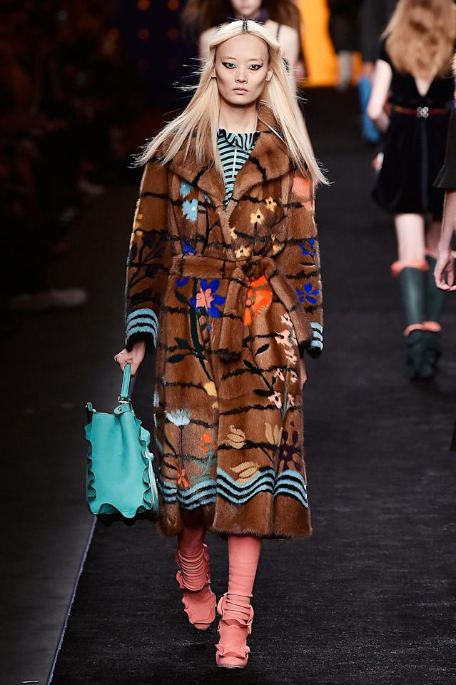 Fendi's floral fur dressing gown coat. (Photo by Catwalking/Getty Images)