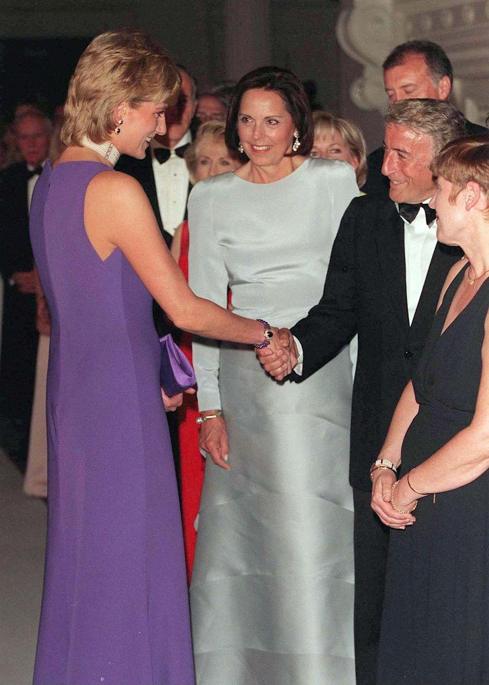 <p>At a gala at the Field Museum of Natural History in Chicago, Tony Bennett donned a classic tuxedo for his introduction to Princess Diana. The Princess wore a purple dress by designer Gianni Versace. </p>