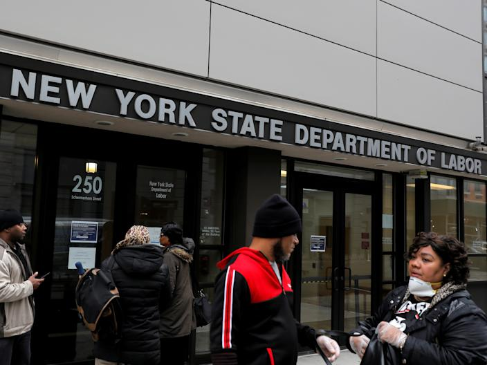 "People gather at the entrance for the New York State Department of Labor offices on March 20, which closed to the public due to the coronavirus outbreak in the Brooklyn borough of New York City. <p class=""copyright"">Andrew Kelly/Reuters</p>"