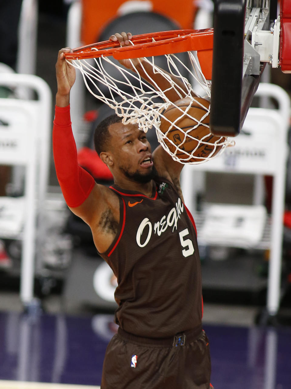 Portland Trail Blazers' Rodney Hood slams the ball home after stealing the ball during the first half of an NBA basketball game Monday, Feb. 22, 2021, in Phoenix. (AP Photo/Darryl Webb)