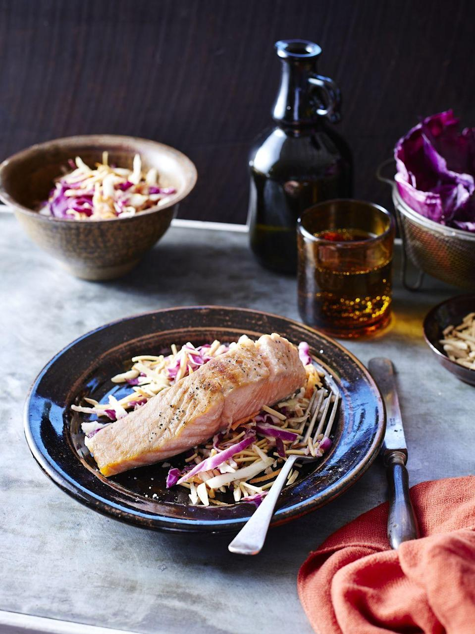 "<p>Serve 4 ounces <a href=""https://www.goodhousekeeping.com/food-recipes/healthy/g817/healthy-salmon-dinners/"" rel=""nofollow noopener"" target=""_blank"" data-ylk=""slk:poached salmon"" class=""link rapid-noclick-resp"">poached salmon</a> with a slaw made by tossing 1 1/4 cups coleslaw mix and 2 sliced scallions with 1 tablespoon of rice vinegar and 1 1/2 teaspoons olive oil. Add spices, herbs, and seasoning as desired. Pair with 3/4 cup of a 100% whole grain (like <a href=""https://www.goodhousekeeping.com/health/diet-nutrition/a48055/quinoa-nutrition/"" rel=""nofollow noopener"" target=""_blank"" data-ylk=""slk:quinoa"" class=""link rapid-noclick-resp"">quinoa</a>) and an apple on the side.</p>"