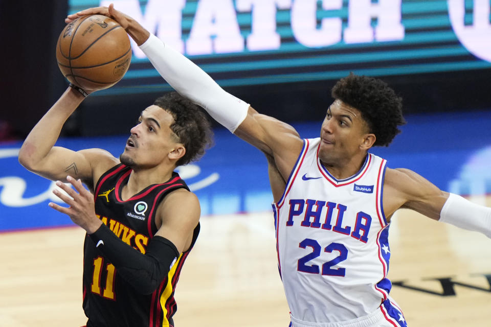 Philadelphia 76ers' Matisse Thybulle, right, blocks a shot by Atlanta Hawks' Trae Young during the second half of Game 7 in a second-round NBA basketball playoff series, Sunday, June 20, 2021, in Philadelphia. (AP Photo/Matt Slocum)