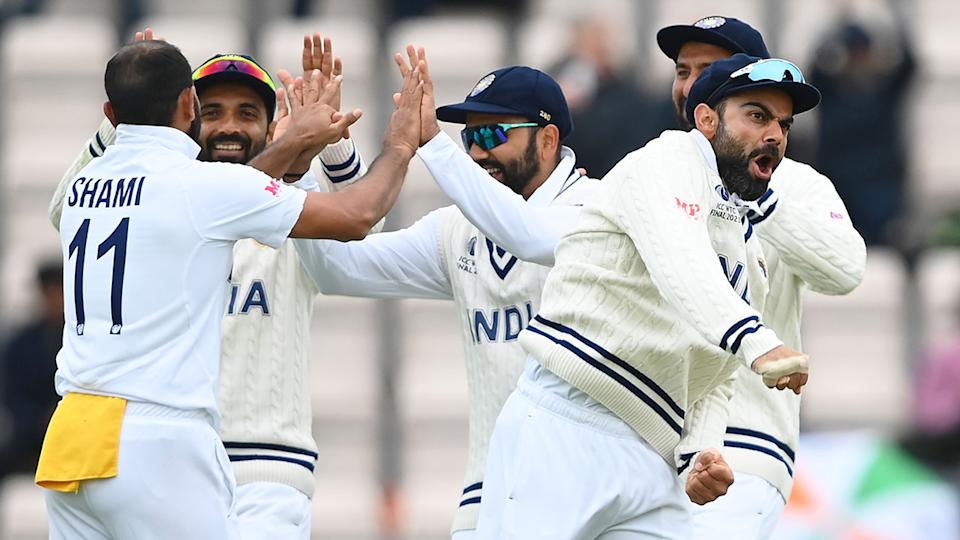 Seen here, India players celebrate a wicket on day five of the World Test Championship final.