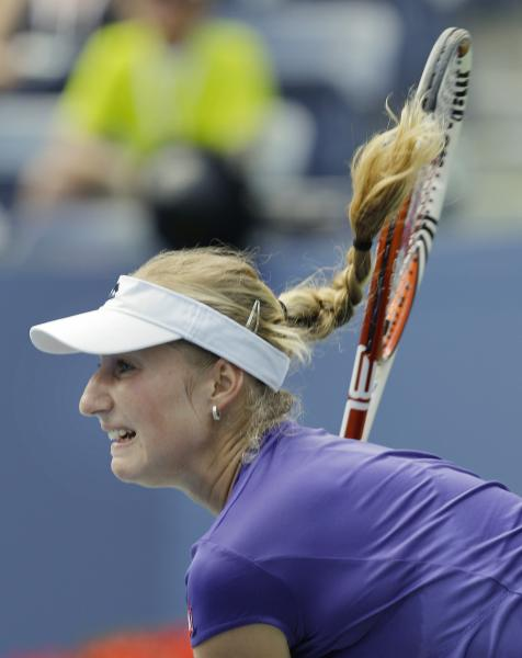 Russia's Ekaterina Makarova returns a shot to Serena Williams in the third round of play at the 2012 US Open tennis tournament, Saturday, Sept. 1, 2012, in New York. (AP Photo/Kathy Willens)