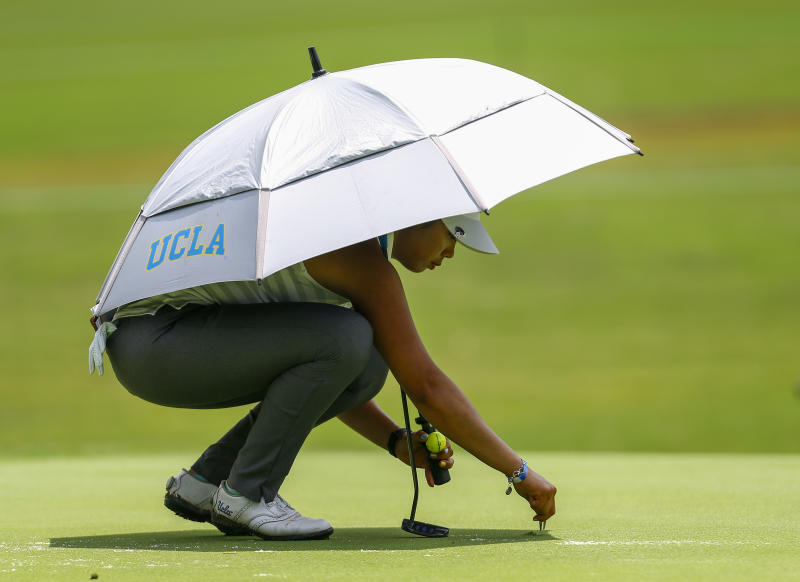 FILE - In this Thursday, May 31, 2018, file photo, Patty Tavatanakit, of Thailand, fixes a divot on the 18th green during the first round of the U.S. Women's Open golf tournament, in Shoal Creek, Ala. Tavatanakit has secured her LPGA Tour card. (AP Photo/Butch Dill, File)