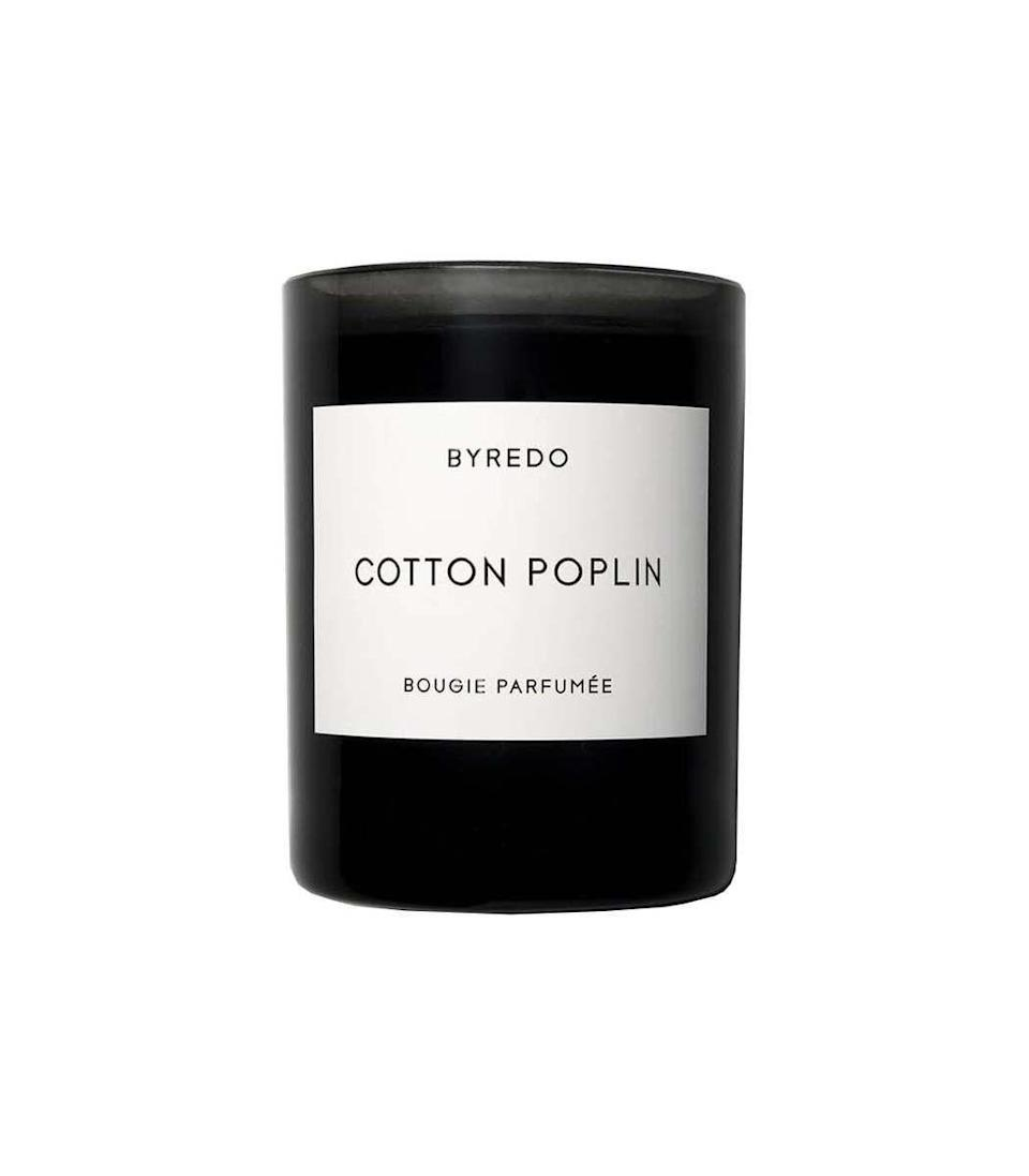 """<p><strong>Byredo</strong></p><p>ShopBAZAAR.com</p><p><strong>$85.00</strong></p><p><a href=""""https://go.redirectingat.com?id=74968X1596630&url=https%3A%2F%2Fshop.harpersbazaar.com%2Fdesigners%2Fbyredo%2Fcotton-poplin-candle-44057.html&sref=https%3A%2F%2Fwww.harpersbazaar.com%2Ffashion%2Fg31944159%2Fmothers-day-gifts-from-daughters%2F"""" rel=""""nofollow noopener"""" target=""""_blank"""" data-ylk=""""slk:Shop Now"""" class=""""link rapid-noclick-resp"""">Shop Now</a></p><p>This fragrance appeals to any crowd, bringing together a juxtaposition of delicate florals and dark woody notes. Gifting Mom with a candle will have her always thinking of you when she's at home.</p>"""