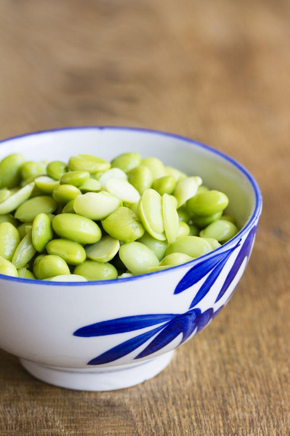 "<p>Edamame packs 9 grams of muscle-building <a href=""https://www.prevention.com/food-nutrition/healthy-eating/a20514733/high-protein-vegetables-and-plant-based-food/"" rel=""nofollow noopener"" target=""_blank"" data-ylk=""slk:plant protein"" class=""link rapid-noclick-resp"">plant protein</a> in just ½ cup for less than 100 calories. These versatile soybeans are also a great source of <a href=""https://www.prevention.com/food-nutrition/a23012367/folate-deficiency-symptoms/"" rel=""nofollow noopener"" target=""_blank"" data-ylk=""slk:folate"" class=""link rapid-noclick-resp"">folate</a> (vitamin B9), <a href=""https://www.prevention.com/food-nutrition/healthy-eating/g20465791/8-foods-that-have-more-iron-than-beef/"" rel=""nofollow noopener"" target=""_blank"" data-ylk=""slk:iron"" class=""link rapid-noclick-resp"">iron</a>, vitamins C and A, and potassium for your heart.<strong><br></strong></p><p><strong>Try it:</strong> Roast some with flaky sea salt or perk up your favorite pasta dish with a handful (we love this <a href=""https://www.prevention.com/food-nutrition/recipes/a20523162/lemony-shells-with-edamame/"" rel=""nofollow noopener"" target=""_blank"" data-ylk=""slk:lemony shells with edamame recipe"" class=""link rapid-noclick-resp"">lemony shells with edamame recipe</a>).</p>"