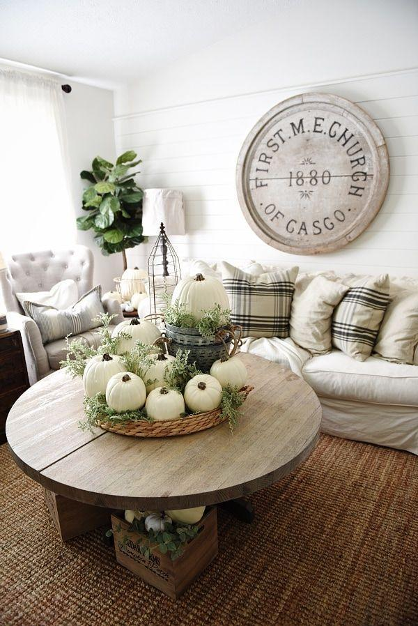 """<p>Your dining table isn't the only place to show off white pumpkins. Here, they add a sophisticated touch to a coffee table in the center of a rustic living room.</p><p><strong>Get the tutorial at <a href=""""https://www.lizmarieblog.com/2015/09/neutral-early-fall-home-tour/"""" rel=""""nofollow noopener"""" target=""""_blank"""" data-ylk=""""slk:Liz Marie Blog"""" class=""""link rapid-noclick-resp"""">Liz Marie Blog</a>.</strong></p><p><strong><strong><strong><strong><a class=""""link rapid-noclick-resp"""" href=""""https://go.redirectingat.com?id=74968X1596630&url=https%3A%2F%2Fwww.walmart.com%2Fsearch%2F%3Fquery%3Dfaux%2Bpumpkins&sref=https%3A%2F%2Fwww.thepioneerwoman.com%2Fhome-lifestyle%2Fdecorating-ideas%2Fg36664123%2Fwhite-pumpkin-decor-ideas%2F"""" rel=""""nofollow noopener"""" target=""""_blank"""" data-ylk=""""slk:SHOP FAUX PUMPKINS"""">SHOP FAUX PUMPKINS</a></strong></strong></strong><br></strong></p>"""