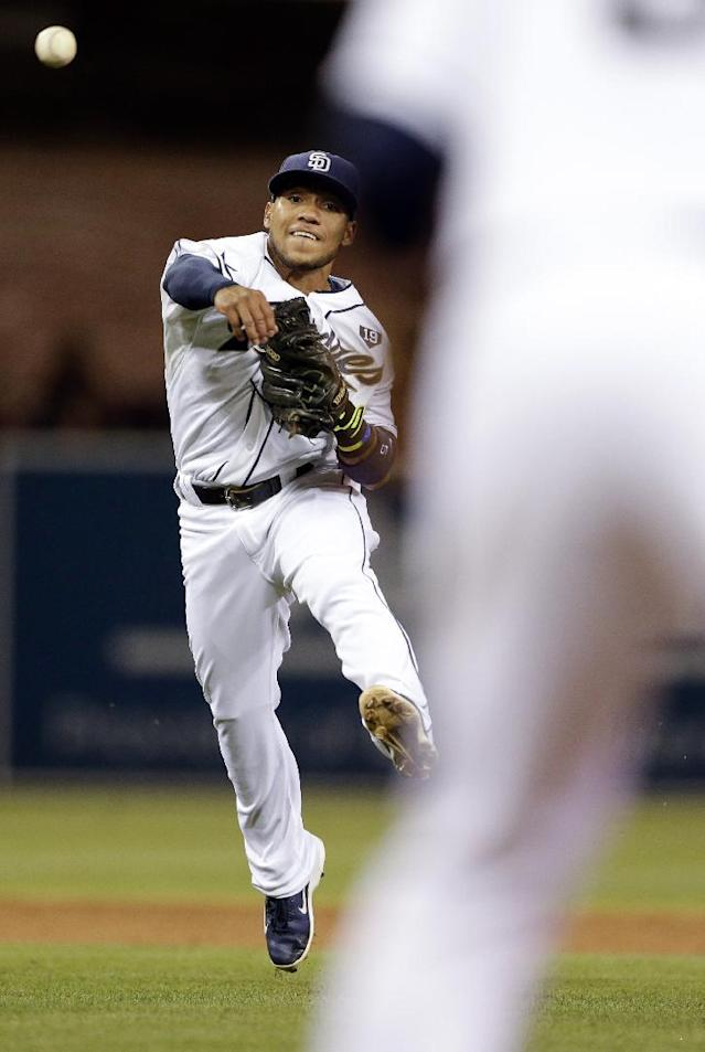 San Diego Padres shortstop Alexi Amarista throws to first for the out on the Arizona Diamondbacks' David Peralta during the sixth inning of a baseball game Tuesday, Sept. 2, 2014, in San Diego. (AP Photo/Gregory Bull)
