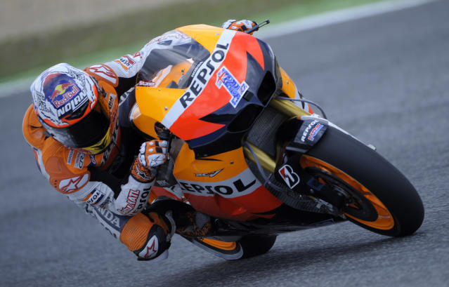 Repsol Honda's Australian Casey Stoner rides during the Moto GP qualifying practice of the Portuguese Grand Prix in Estoril, outskirts of Lisbon, on May 5, 2012. Stoner finished in first place, spanish Dani Pedrosa was second and Cal Crutchlow third. AFP PHOTO / MIGUEL RIOPAMIGUEL RIOPA/AFP/GettyImages