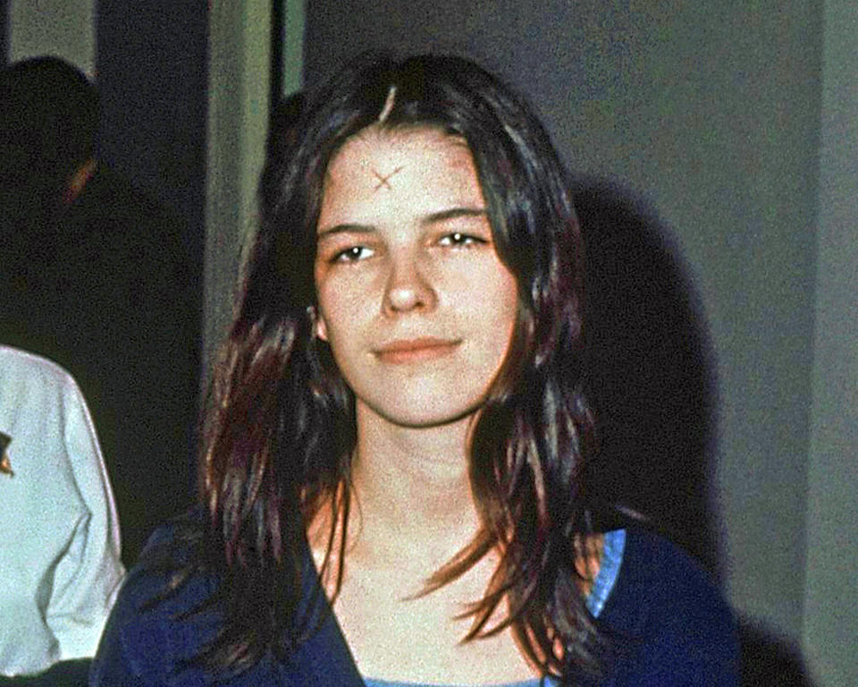 FILE - This March 29, 1971, file photo shows Leslie Van Houten in a Los Angeles lockup. She didn't take part in the Tate killings but accompanied Charles Manson and others to the LaBianca home the next night where she held Rosemary LaBianca down with a pillowcase over her head as she and others stabbed her dozens of times. Van Houten, 69, has earned bachelor's and master's degrees in counseling while in prison and leads several prison programs to help rehabilitate fellow inmates. She has been recommended for parole three times but former Gov. Jerry Brown blocked her release each time. (AP Photo/File)