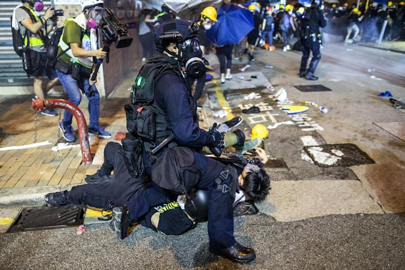 "(Bloomberg) -- China warned that Hong Kong's unrest had gone ""far beyond"" peaceful protest, after a chaotic weekend of tear gas and clashes illustrated the government's struggle to quell a leaderless, unpredictable and widespread movement.China's top agency overseeing Hong Kong condemned ""evil and criminal acts committed by radical elements"" in an unprecedented briefing Monday. While officials reaffirmed support for the city's government and police force, the decision to address foreign media in Beijing signaled growing concern as eight weeks of unprecedented unrest start to shake business confidence in the former British colony.""The central government is in quite a difficult situation over Hong Kong,"" Shi Yinhong, a professor of international relations and director of the Center for American Studies at Renmin University. ""Today's statements by the Hong Kong affairs office generally is to assure that the central government is supporting the Hong Kong government to take more police action against the violent protesters.""The Hong Kong and Macau Affairs Office, which answers to China's cabinet, was compelled to respond after three days of protest that saw unauthorized demonstrations across four districts, including the airport and downtown shopping areas. Police on Sunday night fired clouds of tear gas over demonstrators in the normally buzzing area of Sai Ying Pun, which also hosts the main Chinese government office in Hong Kong.At least 49 people were arrested Sunday after bricks, glass bottles and paint bombs were hurled at police and traffic signs were removed. The events followed a day of clashes in the northwestern suburb of Yuen Long, where a stick-wielding mob had attacked activists a week earlier.As the city cleaned up Monday, the American Chamber of Commerce's Hong Kong chapter urged government action to address grievances underlying the protests, saying steps must be taken to restore sagging confidence and calling for the withdrawal of extradition legislation that sparked demonstrations. A survey of chamber members found deepening perception that Hong Kong had become a ""riskier place"" to do business.The developments raised new fears that the violence may continue to escalate, forcing Chinese President Xi Jinping to send in the military or take other actions that undermine the ""high degree of autonomy"" promised to Hong Kong before its 1997 return. Xi has so far maintained support for the city's embattled leader, Chief Executive Carrie Lam.China's statements supporting the police and playing down any prospect of military action, appeared to relieve some earlier market anxiety. The MSCI Hong Kong Index closed 1.6% lower on Monday, after slipping as much as 2.2%.""What has happened in Hong Kong recently has gone far beyond the scope of peaceful march and demonstration, undermined Hong Kong's prosperity and stability, and touched on the bottom line of the principle of 'one country, two systems',"" HKMAO spokesman Yang Guang said. ""No civilized society under the rule of law would ever allow acts of violence to take place.""Yang didn't rule out military action, pointing to a section of law that gave Hong Kong authorities the power to request support. He outlined three bottom lines for the city: No harm to national security, no challenge to the central government's authority and no using Hong Kong as a base to undermine China.Still, opposition lawmakers said the agency did little to resolve a crisis that they trace to the city's inability to elect its own leaders. In a news conference Monday, lawmakers accused the government of shifting the blame to radical protesters, Western countries and the foreign media.""Beijing tried to make some feeble attempt to help maintain what they assume are the security problems in Hong Kong,"" said Claudio Mo, a legislator and high-profile participant in several peaceful marches. ""That won't help the governance and political crisis that Hong Kong is facing.""The shifting tactics employed by black-shirted protesters on Sunday seemed to catch the police off guard. First, they marched east through the city's central business district, then west, before spontaneously splitting in two. By evening, the police were firing tear gas and rubber bullets in battles with brick-throwing protesters in narrow city streets.Earlier Monday, an edition of the Communist Party's flagship newspaper urged stern action by Hong Kong's police to restore order. ""At a time like this, the Hong Kong Special Administrative Government and the police should not hesitate or have any unnecessary 'psychological worries' about taking necessary steps,"" the piece published in the overseas edition of the People's Daily newspaper said.Since it began, the protest movement has widened to include calls for Lam's resignation and an investigation into the force used by police as they've dispersed crowds. In recent weeks protesters have focused their anger on China itself, amid fears their freedoms are being increasingly restricted under Beijing's rule.""Even Carrie Lam's resignation and universal suffrage aren't going to resolve the crisis in Hong Kong,"" said Oscar Cheung, an office worker in his twenties, as he gathered in a downtown area on Sunday. ""The truth is China is having a tighter and tighter grip on Hong Kong and our rights.""(Updates throughout. An earlier version of this story corrected the name of the Hong Kong Economic Journal.)\--With assistance from Sofia Horta e Costa and Chloe Whiteaker.To contact Bloomberg News staff for this story: Iain Marlow in Hong Kong at imarlow1@bloomberg.net;Dandan Li in Beijing at dli395@bloomberg.net;Jinshan Hong in Hong Kong at jhong214@bloomberg.netTo contact the editors responsible for this story: Brendan Scott at bscott66@bloomberg.net, Karen LeighFor more articles like this, please visit us at bloomberg.com©2019 Bloomberg L.P."
