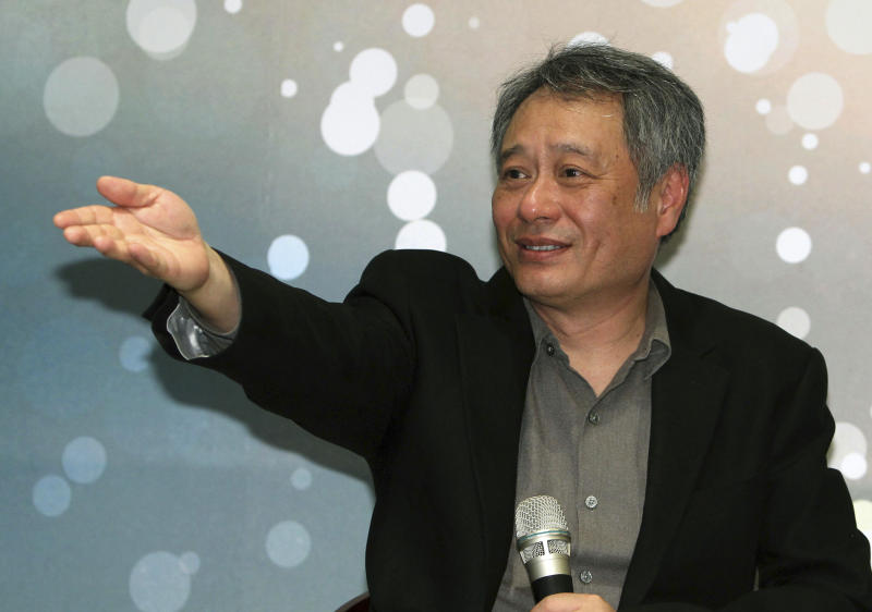 Taiwanese director Ang Lee gestures while speaking during a press conference in Taipei, Taiwan, Thursday, May 9, 2013. The academy award winning director said Thursday that modesty and diligence have been the keys to his success in penetrating the foreign cultures that have framed the backgrounds for many of his most notable films. (AP Photo/Chiang Ying-ying)