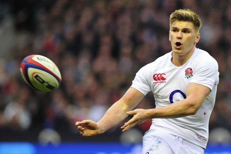 England's fly half Owen Farrell passes the ball during their match against Scotland, in London, on February 2, 2013