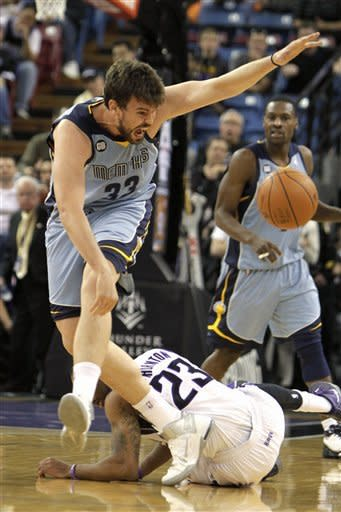 Memphis Grizzlies center Marc Gasol, left, of Spain stumbles over Sacramento Kings; Marcus Thornton (23) as he chases the ball during the first quarter of an NBA basketball game in Sacramento, Calif., Tuesday, March 20, 2012. (AP Photo/Rich Pedroncelli)