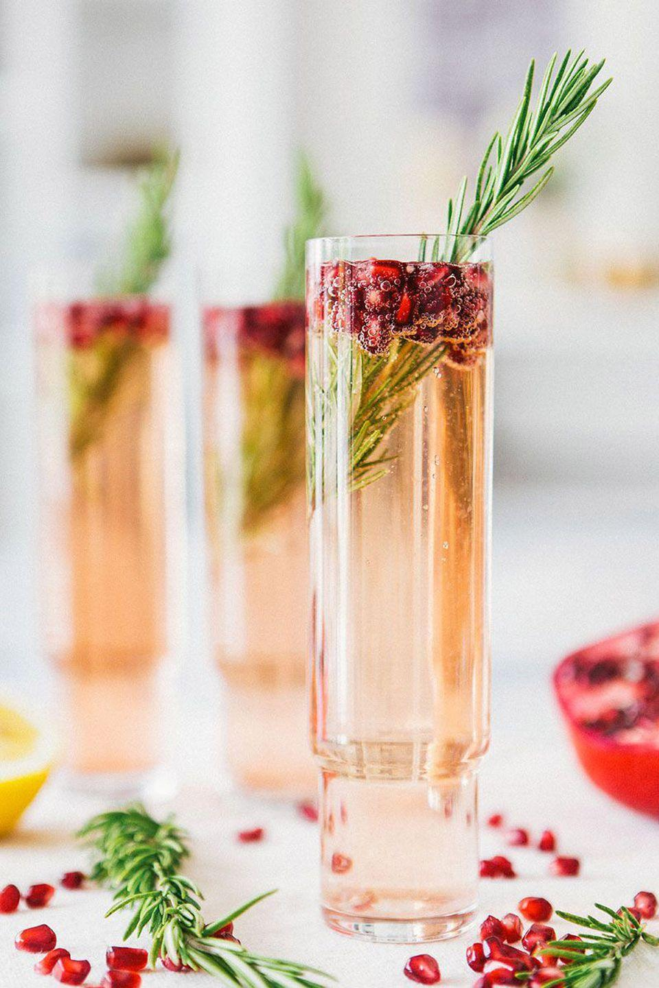 """<p>For an adults-only soiree, host a holiday happy hour. Even if you're not an expert bartender, you can still make gorgeous seasonal drinks—like this <a href=""""http://ahouseinthehills.com/2014/11/04/pomegranate-rosemary-spritzer/"""" rel=""""nofollow noopener"""" target=""""_blank"""" data-ylk=""""slk:pomegranate rosemary spritzer"""" class=""""link rapid-noclick-resp"""">pomegranate rosemary spritzer</a>—with our <a href=""""https://www.countryliving.com/food-drinks/g2768/christmas-cocktails/"""" rel=""""nofollow noopener"""" target=""""_blank"""" data-ylk=""""slk:easy Christmas cocktails recipes"""" class=""""link rapid-noclick-resp"""">easy Christmas cocktails recipes</a> .</p>"""