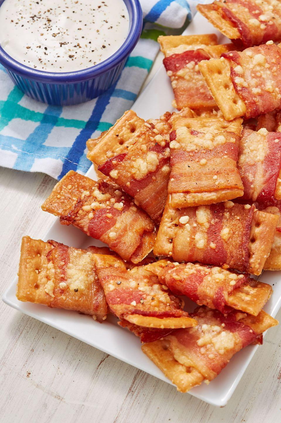 """<p>Three simple ingredients make this insanely addictive snack.</p><p>Get the recipe from <a href=""""https://www.delish.com/cooking/recipe-ideas/recipes/a52549/bacon-crack-bites-recipe/"""" rel=""""nofollow noopener"""" target=""""_blank"""" data-ylk=""""slk:Delish"""" class=""""link rapid-noclick-resp"""">Delish</a>.</p>"""
