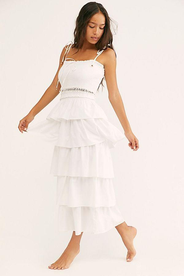"""<p>This <a href=""""https://www.popsugar.com/buy/Free-People-Sunset-Dancing-Dress-544298?p_name=Free%20People%20Sunset%20Dancing%20Dress&retailer=freepeople.com&pid=544298&price=128&evar1=fab%3Aus&evar9=46171681&evar98=https%3A%2F%2Fwww.popsugar.com%2Ffashion%2Fphoto-gallery%2F46171681%2Fimage%2F47157424%2FFree-People-Sunset-Dancing-Dress&list1=shopping%2Cdresses%2Csummer%2Ccotton%2Csummer%20fashion&prop13=api&pdata=1"""" rel=""""nofollow"""" data-shoppable-link=""""1"""" target=""""_blank"""" class=""""ga-track"""" data-ga-category=""""Related"""" data-ga-label=""""https://www.freepeople.com/shop/sunset-dancing-dress/?category=SEARCHRESULTS&amp;color=010"""" data-ga-action=""""In-Line Links"""">Free People Sunset Dancing Dress</a> ($128) will inevitably sell out.</p>"""