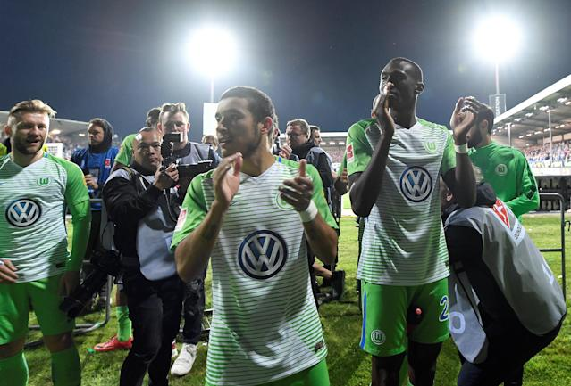 Soccer Football - Bundesliga Promotion/Relegation Playoff Second Leg - Holstein Kiel vs VfL Wolfsburg - Holstein-Stadion, Kiel, Germany - May 21, 2018 Wolfsburg's William and Josuha Guilavogui applaud fans after the match REUTERS/Fabian Bimmer DFL RULES TO LIMIT THE ONLINE USAGE DURING MATCH TIME TO 15 PICTURES PER GAME. IMAGE SEQUENCES TO SIMULATE VIDEO IS NOT ALLOWED AT ANY TIME. FOR FURTHER QUERIES PLEASE CONTACT DFL DIRECTLY AT + 49 69 650050