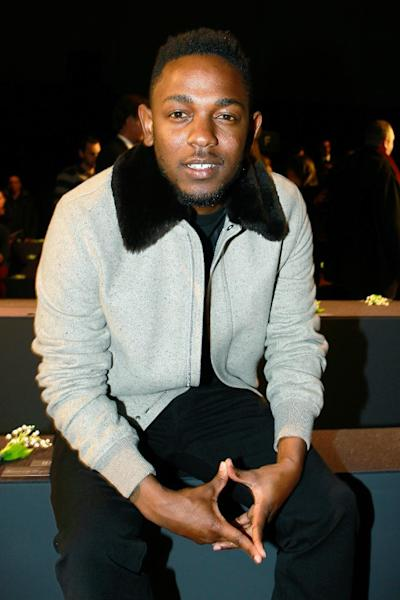 FILE - In this Saturday, Jan. 18, 2014 file photo, rap singer Kendrick Lamar attends the Dior men's Fall-Winter 2014-2015 fashion collection, in Paris. Lamar is taking a philosophical approach to being shut out at the Grammy Awards on Jan. 26, 2014. Lamar, one of Sunday night's top nominees with seven nods, was shut out, prompting four-time winner Macklemore to send a text of apology later that night after winning best rap album. (AP Photo/Jacques Brinon, File)