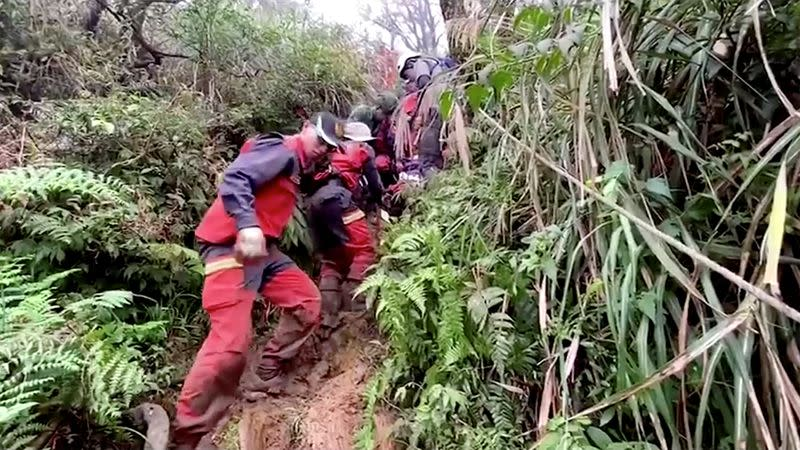 A rescue team searches for missing military officers, after a Black Hawk helicopter made a forced landing at a mountainous area near Taipei
