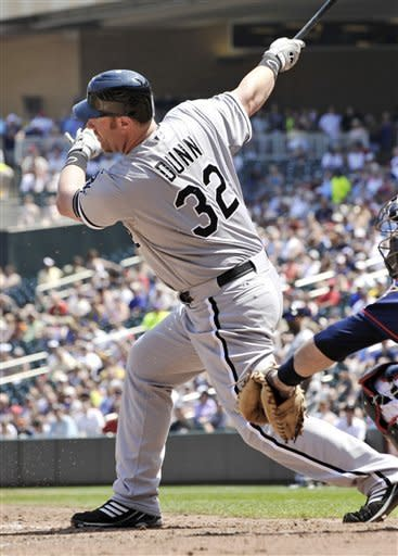 Chicago White Sox' Adam Dunn singles in the eighth inning of a baseball game against the Minnesota Twins, Wednesday, June 27, 2012 in Minneapolis. Dunn went 3-for-5 including a three-run home run as the White Sox won 12-5. (AP Photo/Jim Mone)