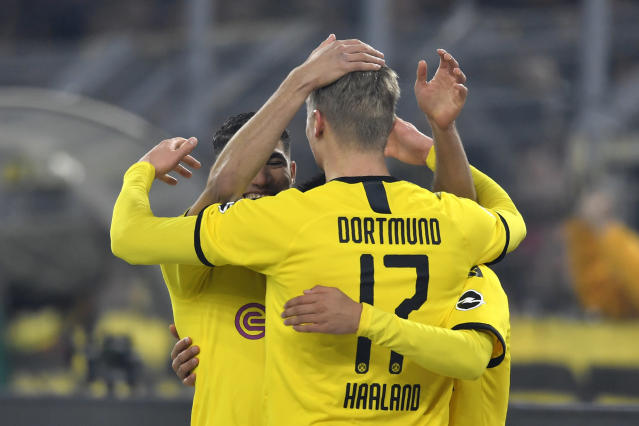 Dortmund's Erling Braut Haaland, centre, celebrates with teammates after scoring his side's third goal during the German Bundesliga soccer match between Borussia Dortmund and Eintracht Frankfurt in Dortmund, Germany, Friday, Feb. 14, 2020. (AP Photo/Martin Meissner)
