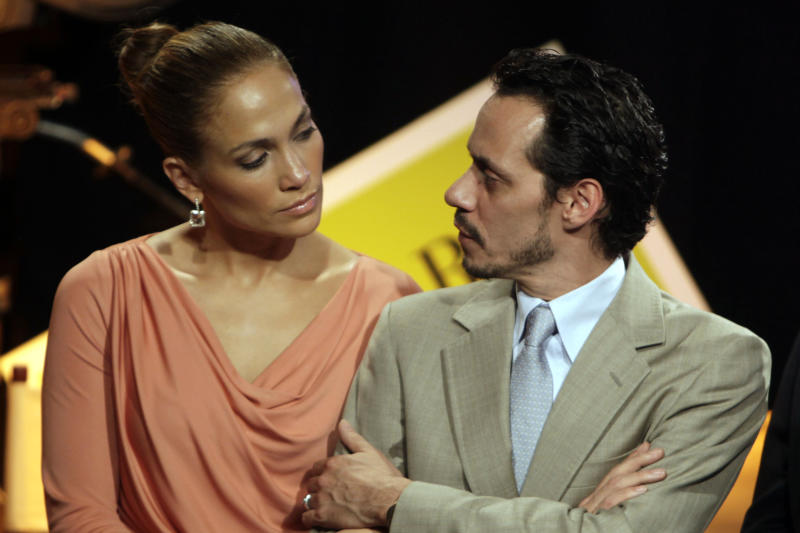 """In this Friday March 4, 2011 picture, Jennifer Lopez, left, and husband Marc Anthony attend a signing ceremony for filmmaking incentive legislation for the U.S. island territory in Bayamon, Puerto Rico. The superstar couple announced Friday, July 15, 2011 they are breaking up. The two married in 2004 and have 3-year-old twins, Max and Emme. In a Friday statement from her publicist, the pair called the decision to end their marriage a """"very difficult decision."""" They say they have come to an """"amicable decision"""" on all matters and ask for privacy. It's Lopez's third marriage, Anthony's second. (AP Photo/Ricardo Arduengo)"""