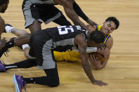 Golden State Warriors guard Jordan Poole (3) battles for a loose ball against Sacramento Kings guard Delon Wright (55) during the first half of an NBA basketball game on Sunday, April 25, 2021, in San Francisco. (AP Photo/Tony Avelar)
