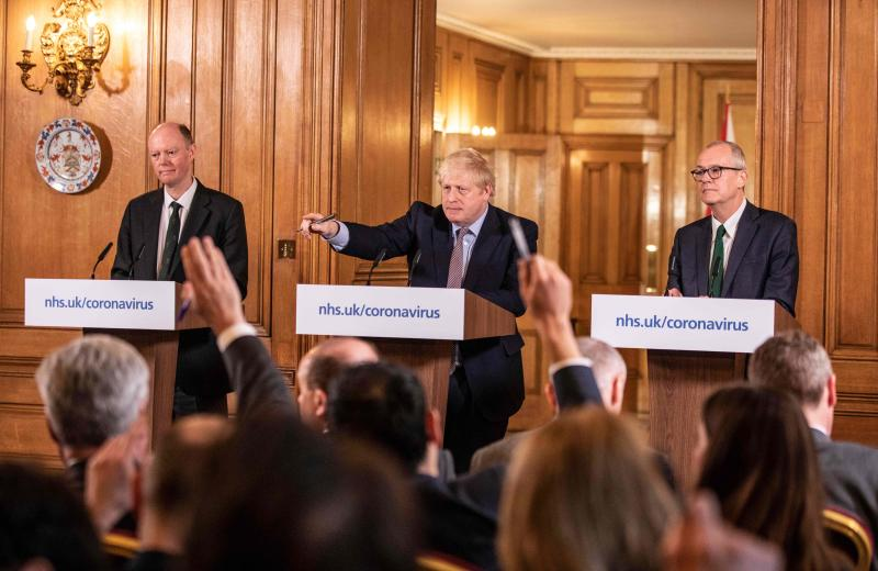 Prime Minister Boris Johnson gives a press conference on the ongoing COVID-19 situation with chief medical officer Chris Whitty (L) and Chief scientific officer Sir Patrick Vallance, in London on March 16, 2020. (Photo by Richard Pohle / POOL / AFP) (Photo by RICHARD POHLE/POOL/AFP via Getty Images)