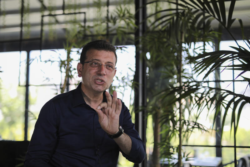 Ekrem Imamoglu, candidate of the secular opposition Republican People's Party, or CHP, ahead of June 23 re-run of Istanbul elections, talks to The Associated Press, in Istanbul, Monday, June 17, 2019. The 49-year-old candidate won the March 31 local elections with a slim majority, but after weeks of recounting requested by the ruling party, Turkey's electoral authority annulled the result of the vote, revoked Imamoglu's mandate and ordered the new election. (AP Photo/Emrah Gurel)