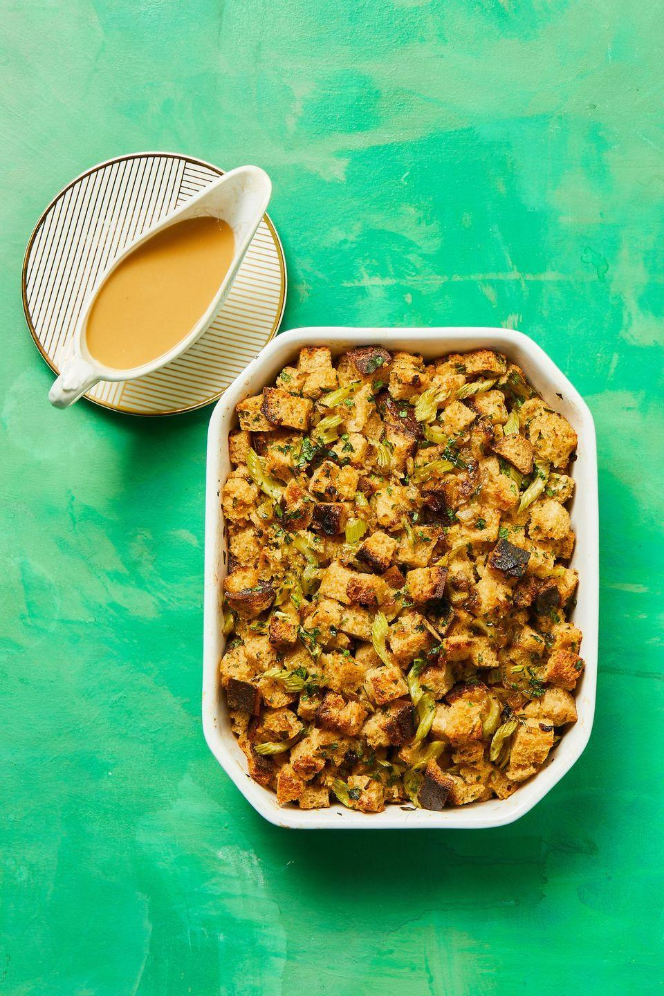 """<p>Sourdough provides the perfect amount of tang to balance this buttery stuffing, which is packed with fresh thyme and parsley.</p><p><strong><em><a href=""""https://www.womansday.com/food-recipes/a34129159/sourdough-herb-stuffing-recipe/"""" rel=""""nofollow noopener"""" target=""""_blank"""" data-ylk=""""slk:Get the Sourdough Herb Stuffing recipe."""" class=""""link rapid-noclick-resp"""">Get the Sourdough Herb Stuffing recipe. </a></em></strong></p>"""