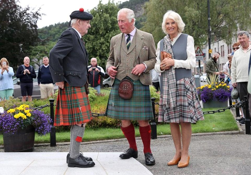 Charles wore a kilt in Balmoral tartan complete with a sporran and a Tweed blazer while Camilla wore a matching grey tartan shawl  (Getty Images)
