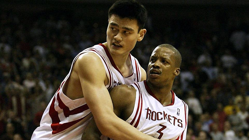Yao Ming holds back Rockets teammate Steve Francis (Getty Images).