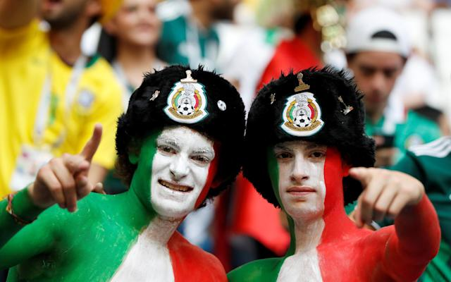 <p>Mexico fans before the match REUTERS/Carlos Garcia Rawlins </p>