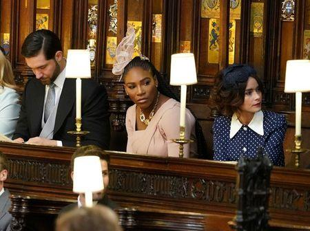 (Left to right) Alexis Ohanian, Serena Williams and Abigail Leigh Spencer take their seats in St George's Chapel at Windsor Castle for the wedding of Prince Harry to Meghan Markle. Saturday May 19, 2018. Dominic Lipinski/Pool via REUTERS