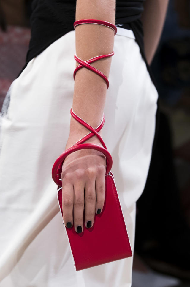 <p><i>Red rectangular wristlet from the SS18 Creatures of Comfort collection. (Photo: ImaxTree) </i></p>
