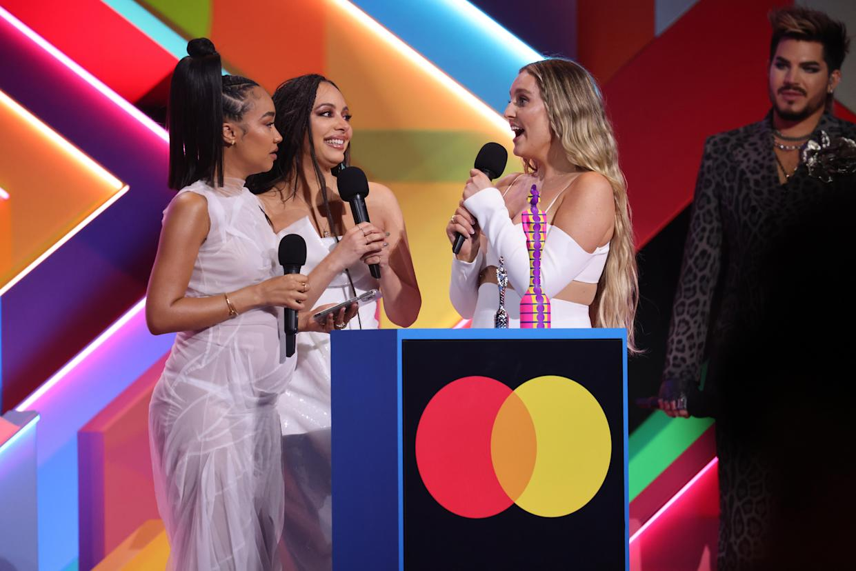 LONDON, ENGLAND - MAY 11: Leigh-Anne Pinnock, Jade Thirlwall and Perrie Edwards of Little Mix on stage after winning the British Group award during The BRIT Awards 2021 at The O2 Arena on May 11, 2021 in London, England. (Photo by JMEnternational/JMEnternational for BRIT Awards/Getty Images)