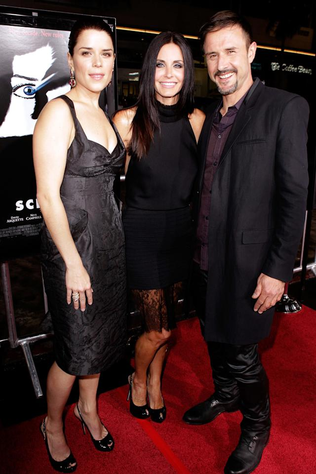 """Original (and returning) """"Scream"""" castmates <a href=""""http://movies.yahoo.com/movie/contributor/1800018951"""">Neve Campbell</a>, <a href=""""http://movies.yahoo.com/movie/contributor/1800024387"""">Courteney Cox</a>, and <a href=""""http://movies.yahoo.com/movie/contributor/1800019202"""">David Arquette</a> reunited on the red carpet at the Los Angeles premiere of <a href=""""http://movies.yahoo.com/movie/1810035905/info"""">Scream 4</a>. Upon arriving, David -- who's been separated from Courteney for six months -- professed his unyielding commitment to his wife and family. """"My family and friends have been amazing. I love them so much and I really... I just can't say enough about how much I love them,"""" he said. """"[Courteney is] a sweet amazing woman and... we're family still, so no matter what happens, we'll be kind and honorable to each other and be together forever."""""""