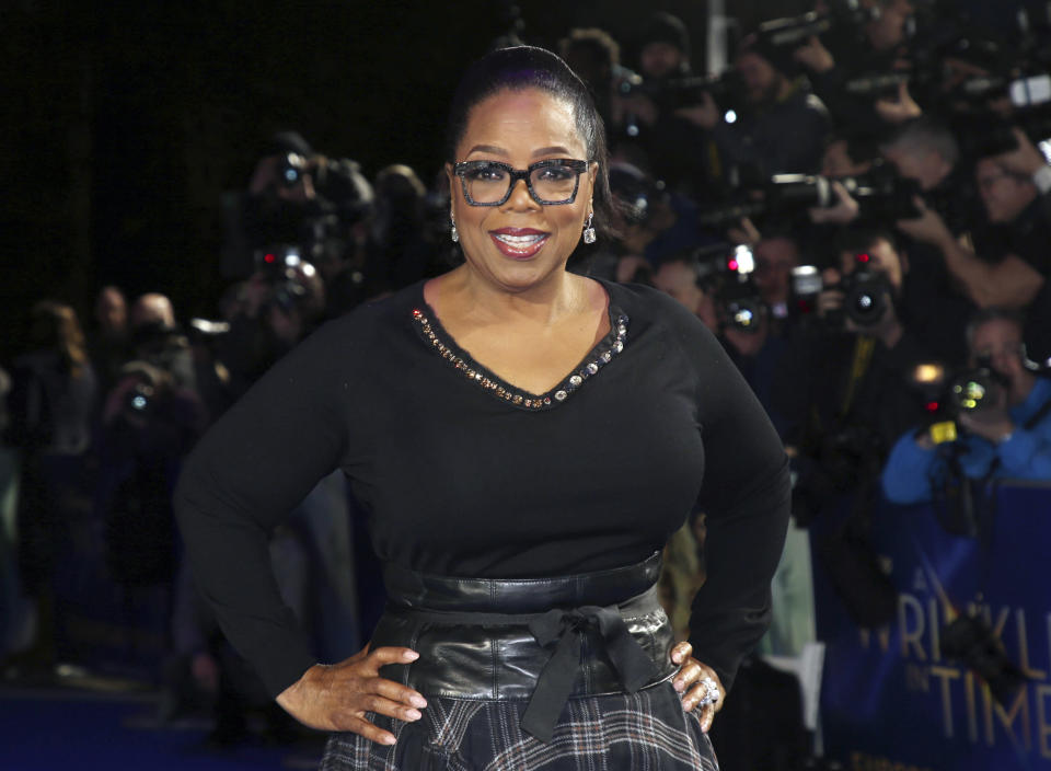 "FILE - In this March 13, 2018, file photo, actress Oprah Winfrey poses for photographers upon arrival at the premiere of the film ""A Wrinkle In Time"" in London. O, The Oprah Magazine is ending its regular monthly print editions with the December 2020 issue after 20 years of publication. The brand, which is among the most recognizable magazines in the U.S., is not going away but will become more ""more digitally-centric,"" said a Hearst spokeswoman Monday. (Photo by Joel C Ryan/Invision/AP, File)"