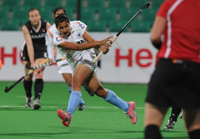 Rani Rampal of India (C) plays a shot during their women's field hockey match against Canada of the FIH London 2012 Olympic Hockey qualifying tournament at the Major Dhyan Chand National Stadium in New Delhi on February 19, 2012. AFP PHOTO/ Prakash SINGH (Photo credit should read PRAKASH SINGH/AFP via Getty Images)