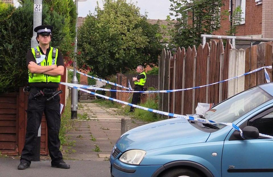 Police officers at the scene in Naburn Fold, in the Whinmoor area of Leeds (PA) (PA Wire)