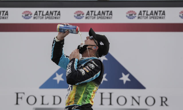 Kevin Harvick celebrates after winning a NASCAR Cup Series auto race at Atlanta Motor Speedway on Sunday. (AP Photo/Brynn Anderson)