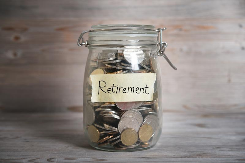 "A jar filled with coins and labeled ""Retirement"""